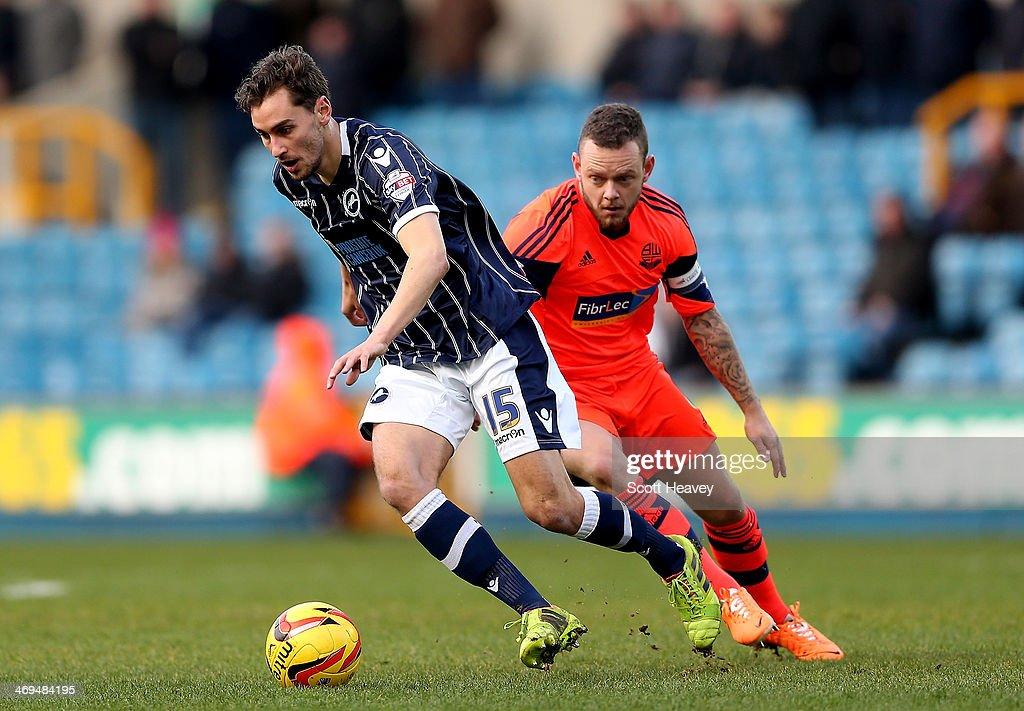 Ed Upson of Millwall in action with Jay Spearing of Bolton during the Sky Bet Championship match between Millwall and Bolton Wanderers at The Den on February 15, 2014 in London, England.