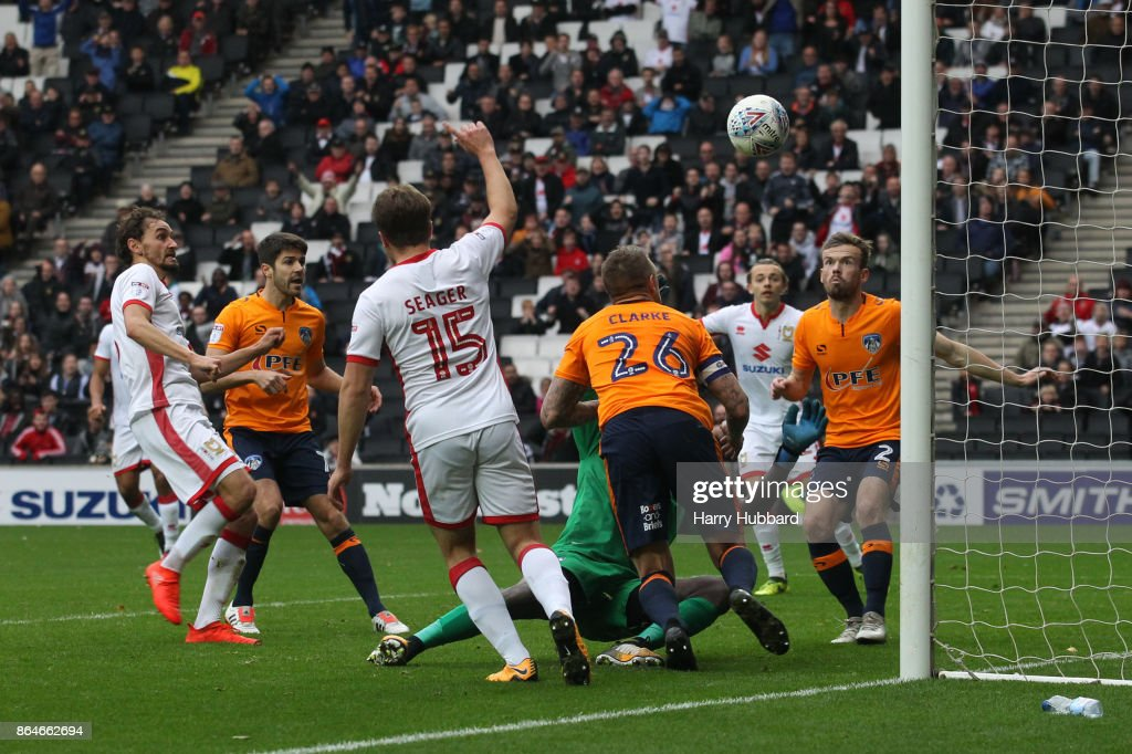 Ed Upson of Milton Keynes Dons scores his side's fourth goal during the Sky Bet League One match between Milton Keynes Dons and Oldham Athletic at StadiumMK on October 21, 2017 in Milton Keynes, England.