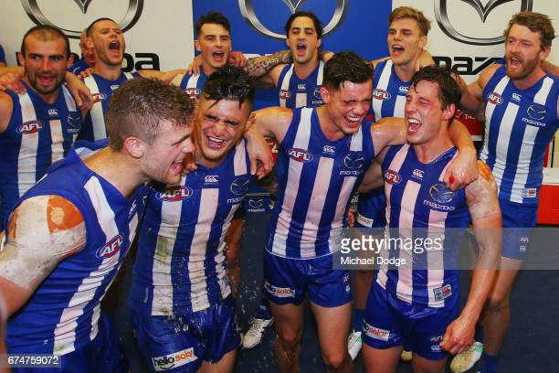 Ed VickersWillis Marley Williams Jy Simpkin of the Kangaroos and Nathan Hrovat of the Kangaroos celebrate their first win with the club during the...