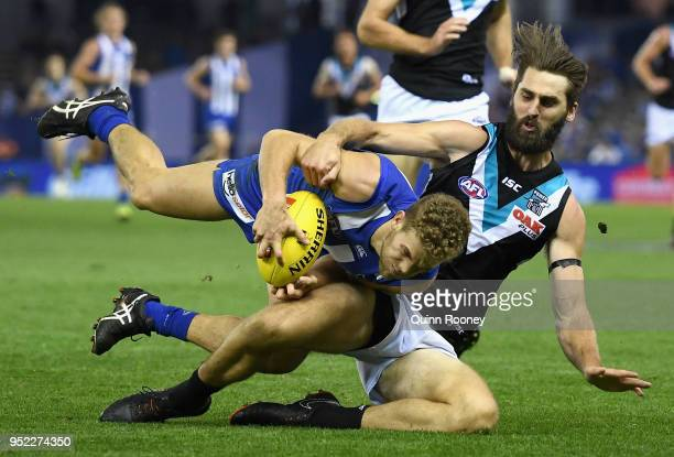 Ed Vickers-Willis of the Kangaroos is tackled Justin Westhoff of the Power during the round six AFL match between the North Melbourne Kangaroos and...