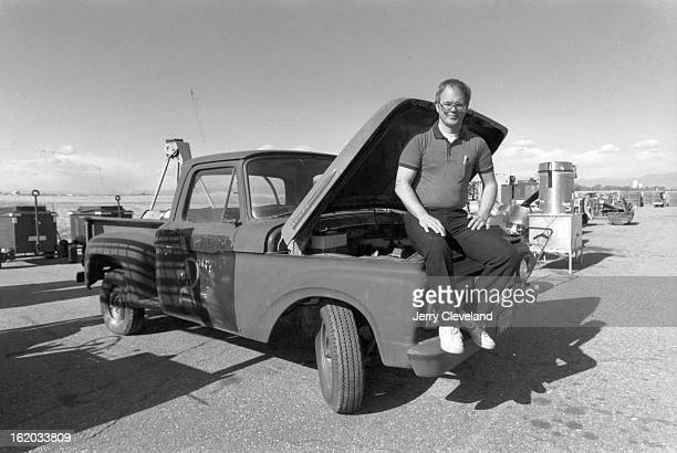 5/9/1998 Ed Welch of the Property Disposal Office at Rocky Mountain Arsenal sits on the fender of a US Army 1961 Ford pickup to be auctioned in an...