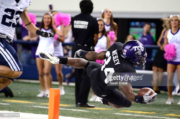 Ed Wesley of the TCU Horned Frogs dives in the endzone during a game against the BYU Cougars at Cowboys Stadium on October 28 2011 in Arlington Texas...