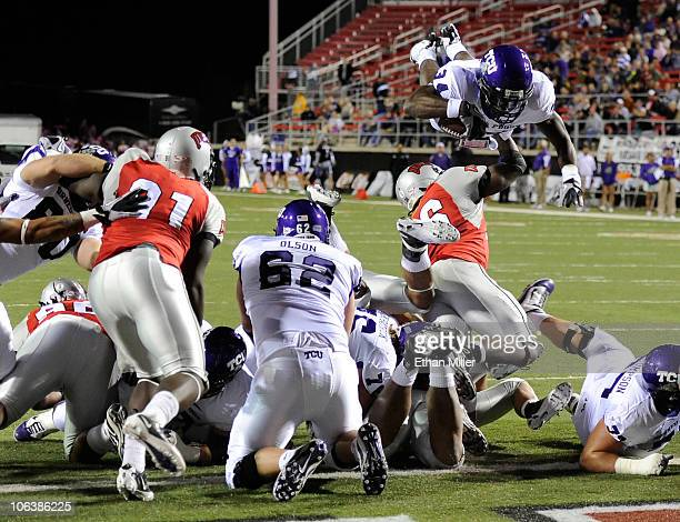 Ed Wesley of the Texas Christian University Horned Frogs jumps over players at the goal line to score a touchdown against the UNLV Rebels during the...