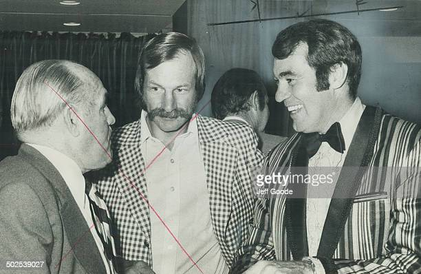 Ed Westfall winner of Charlie Conacher Memorial Trophy enjoys laugh as he chats with Maple Leafs' vicepresident King Clancy and Eddie Shack before...