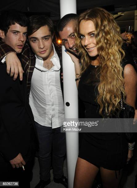 Ed Westwick and Lindsay Lohan attends the Dolce Gabbana and The Cinema Society Celebration for Madonna and the cast of Filth and Wisdom at The...