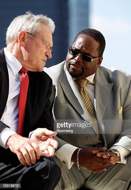 Ed Whitacre, chairman and chief executive officer of General Motors Co., left, and Jimmy Settles, vice president of the United Auto Workers, chat...