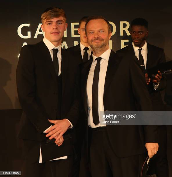 Ed Woodward and Brandon Williams of Manchester United take part in a game at the annual Manchester United UNICEF Dinner at Old Trafford on November...
