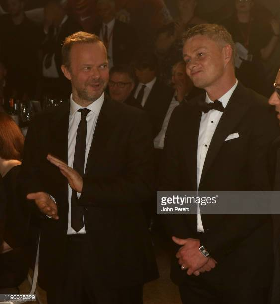 Ed Woodward and Manager Ole Gunnar Solskjaer of Manchester United take part in a game at the annual Manchester United UNICEF Dinner at Old Trafford...