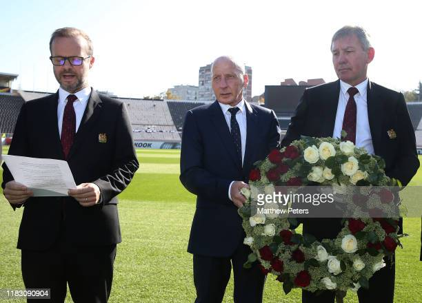 Ed Woodward Bryan Robson and Mickey Thomas of Manchester United attend a ceremony to remember the victims of the Munich Air Disaster at Stadion FK...