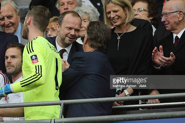 LONDON ENGLAND MAY 21 Ed Woodward the executive vicechairman of Manchester United greets Louis van Gaal Manager / head coach of Manchester United and...