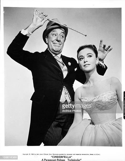 Ed Wynn holds a wand above Anna Maria Alberghetti in publicity portrait for the film 'Cinderfella' 1960