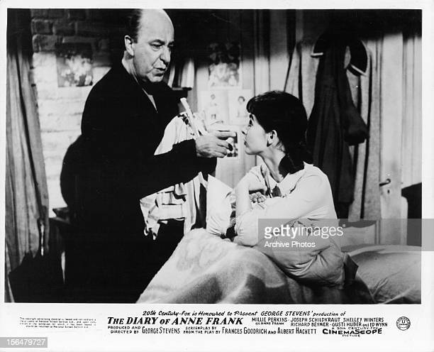 Ed Wynn takes care of Millie Perkins in a scene from the film 'The Diary Of Anne Frank' 1959