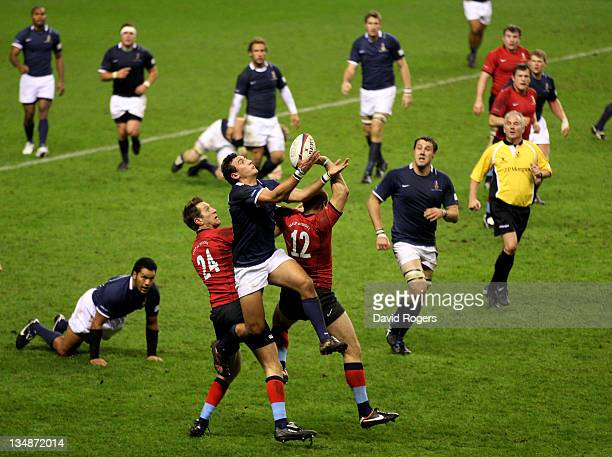 Ed Yarnton of the Southern Hemisphere XV claims a high ball during the Help For Heroes Rugby Challenge match between the H4H Northern Hemisphere XV...