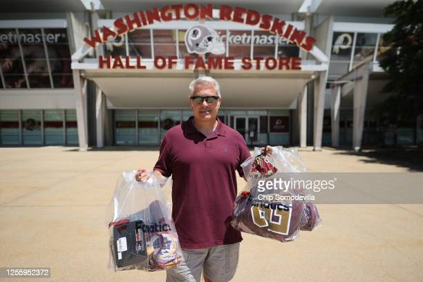 Ed Zierle of Annapolis Maryland poses with his bags of newly purchased merchandise from the Washington Redskins Hall of Fame Store at FedEx Field...