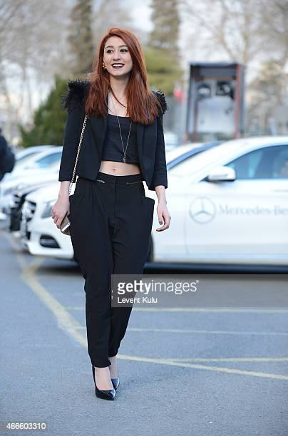 Eda Kucuksubasi poses wearing jacket by Twist pants byTop Shop shoes by Steve Maden and hand bag by Pinko during Mercedes Benz Fashion Week Istanbul...