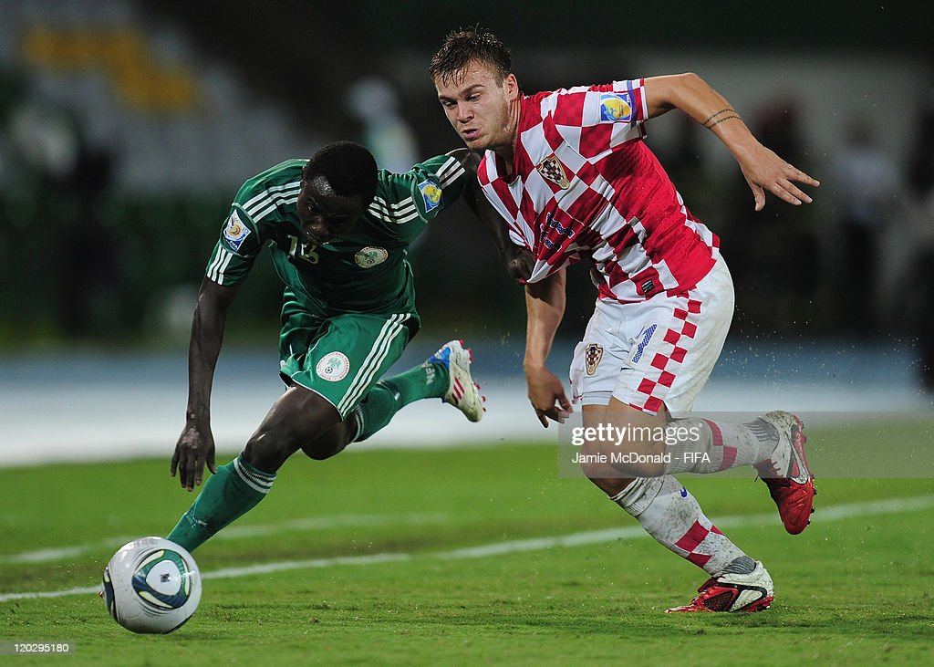 Edafe Egbedi of Nigeria battles with Mario Ticinovic of Croatia during the FIFA U-20 World Cup Group D match between Croatia and Nigeria at the Estadio Centenario on August 3, 2011 in Armenia, Colombia.