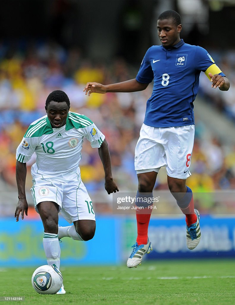 Edafe Egbedi (L) of Nigeria duels for the ball with Gueida Fofana of France during the FIFA U-20 World Cup Colombia 2011 quarter final match between France and Nigeria on August 14, 2011 in Cali, Colombia.