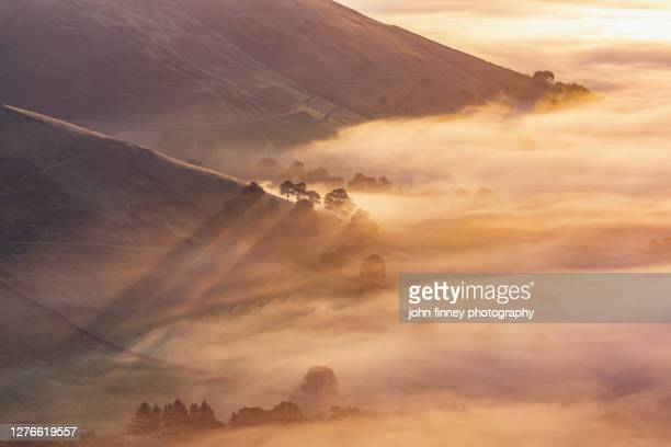 edale valley september sunrise over valley mists. derbyshire, peak district. - rural scene stock pictures, royalty-free photos & images