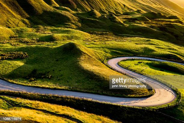 edale valley twisty road at sunset. english peak district. uk - snake stock pictures, royalty-free photos & images