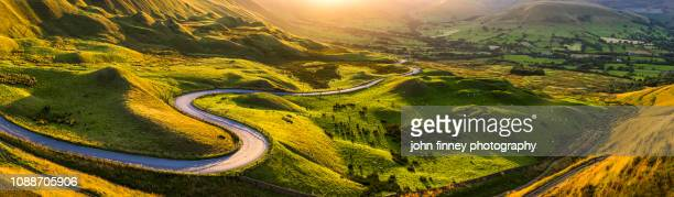edale valley twisty road at sunset large panoramic. english peak district. uk - snake stock pictures, royalty-free photos & images