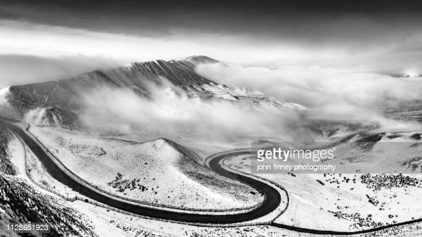 Edale valley winding road misty winter sunrise. English Peak District. UK