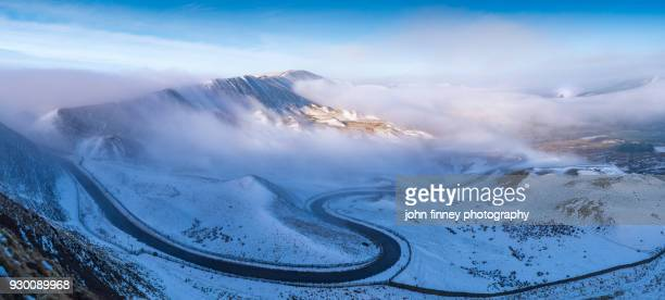 Edale valley with mist and snow in the English Peak District. UK.