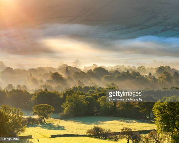 edale village sunrise with mist and fog and golden light at sunrise. english peak district. uk. - english culture stock pictures, royalty-free photos & images