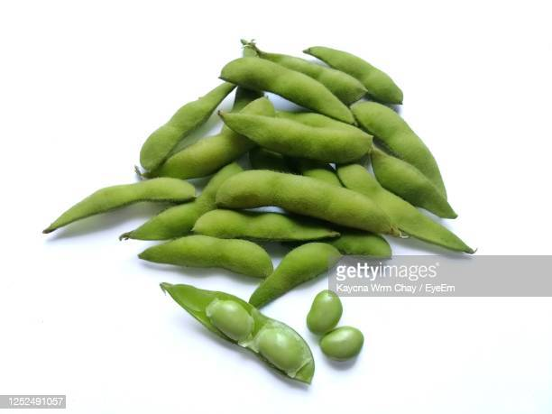 edamame, green soybean isolated on white background - green bean stock pictures, royalty-free photos & images