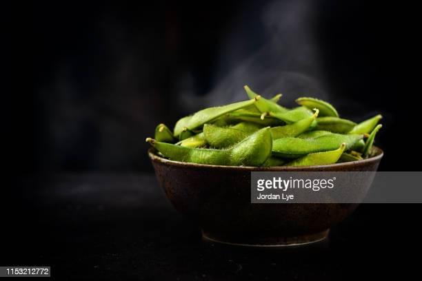 edamame with smoke - edamame stock pictures, royalty-free photos & images