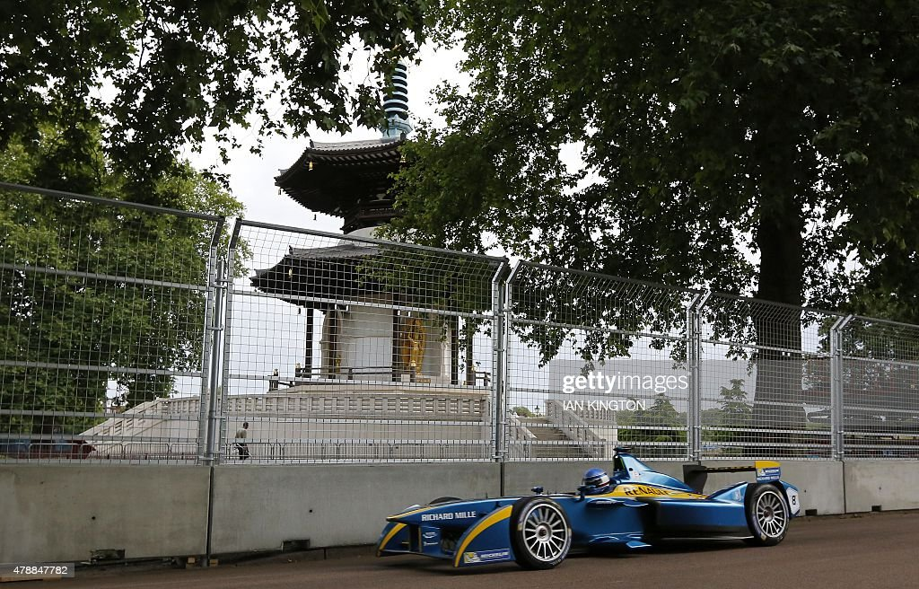 E.Dams-Renaults French driver Nicolas Prost drives past the peace pagoda during a non-qualifying practice during the 2015 FIA Formula E London ePrix Championship at Battersea Park in London, on June 28, 2015.