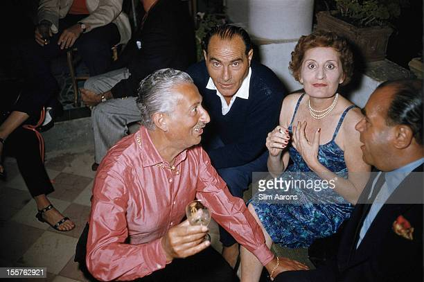Edda Ciano, Countess of Cortellazzo and Buccari , sitting with Pietro Capuano and two other men on the island of Capri, Italy, in July 1958. Ciano is...