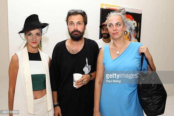 Edda Gudmundsdottir Daniel Palillo and artist Shoplifter attend Daniel Palillo SS15 'Paintings About The Fashion World' at The Hole Gallery on...