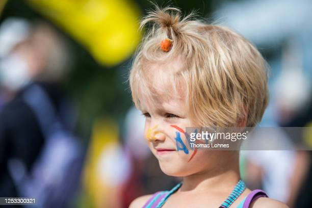 Edda has the letters AKW with an X painted on her face while she attends the 480th picket of the anti-nuclear activists on the Rhine bridge...