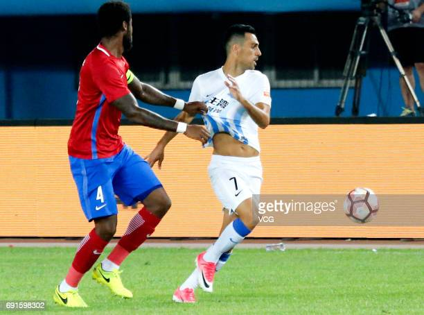 Eddi Gomes of Henan Jianye and Eran Zahavi of Guangzhou RF compete for the ball during the 12th round match of 2017 Chinese Football Association...