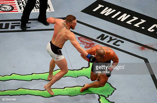 Eddie Alvarez of the United States fights against Conor McGregor of Ireland in their lightweight championship bout during the UFC 205 event at...