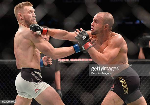 Eddie Alvarez punches Conor McGregor of Ireland in their UFC lightweight championship fight during the UFC 205 event at Madison Square Garden on...