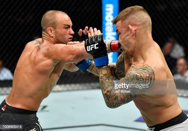 Eddie Alvarez punches Dustin Poirier in their lightweight bout during the UFC Fight Night event at Scotiabank Saddledome on July 28, 2018 in Calgary,...