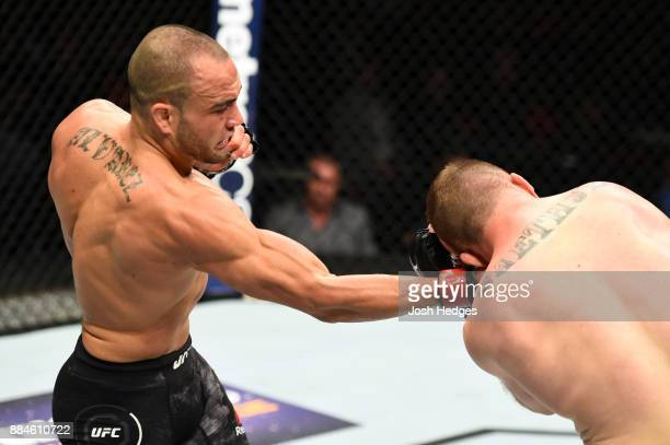 Eddie Alvarez punches Justin Gaethje in their lightweight bout during the UFC 218 event inside Little Caesars Arena on December 02 2017 in Detroit...