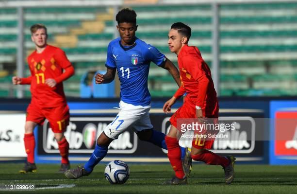 Eddie Anthony Salcedo Mora of Italy U19 competes for the ball with Othman Boussaid of Belgium U19 during the UEFA Elite Round match between Italy U19...