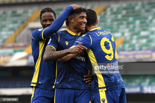 Eddie Anthony Salcedo of Hellas Verona celebrates with Matteo Lovato and Kevin Lasagna after scoring their side's first goal during the Serie A match...