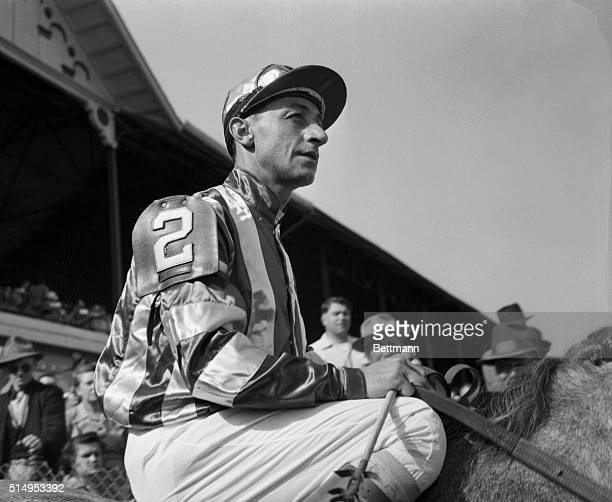 Eddie Arcaro rides proudly to post in sixth race, 5/1/53. He will be trying for his sixth Derby win, 5/2/53.