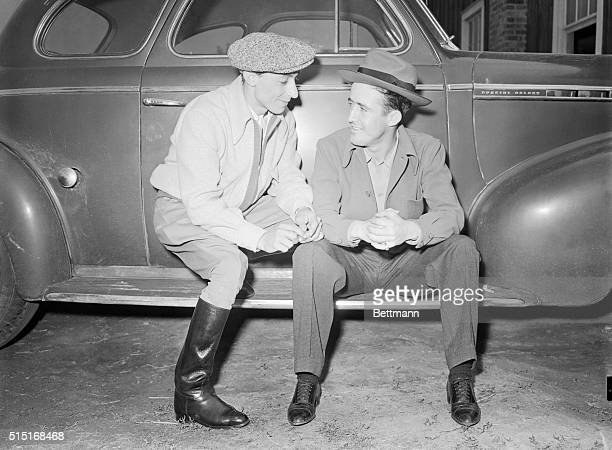 Eddie Arcaro, who will ride Whirlaway, and Buddy Haas, who'll be up on Porter's Cap, a heavy favorite, exchange pre-Derby chatter on the eve of the...