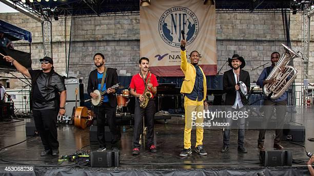 Eddie Barbash Jon Batiste Joe Saylor and Ibanda Ruhumbika of Stay Human performs during the 2014 Newport Jazz Festival at Fort Adams State Park on...