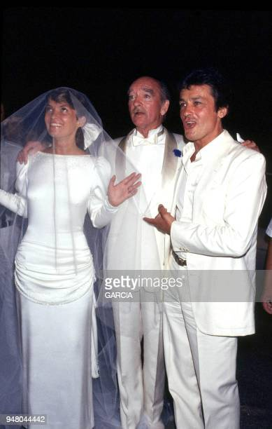 Eddie Barclay with his seventh wife Cathy Esposito and Alain Delon
