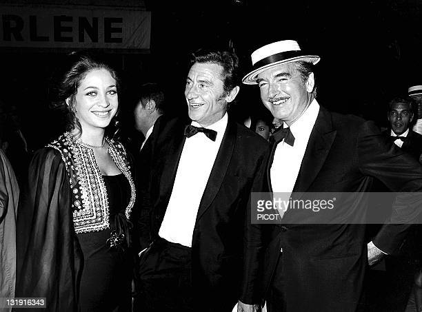 Eddie Barclay with his third wife MarieChristine Steinberg and French actor Robert Lamoureux at the 80th birthday of French singer Maurice Chevalier...
