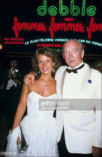 Eddie Barclay with his wife Cathy Esposito at the gala 'Moulin Rouge' with Dean Martin in ParisFrance on July 4th1984