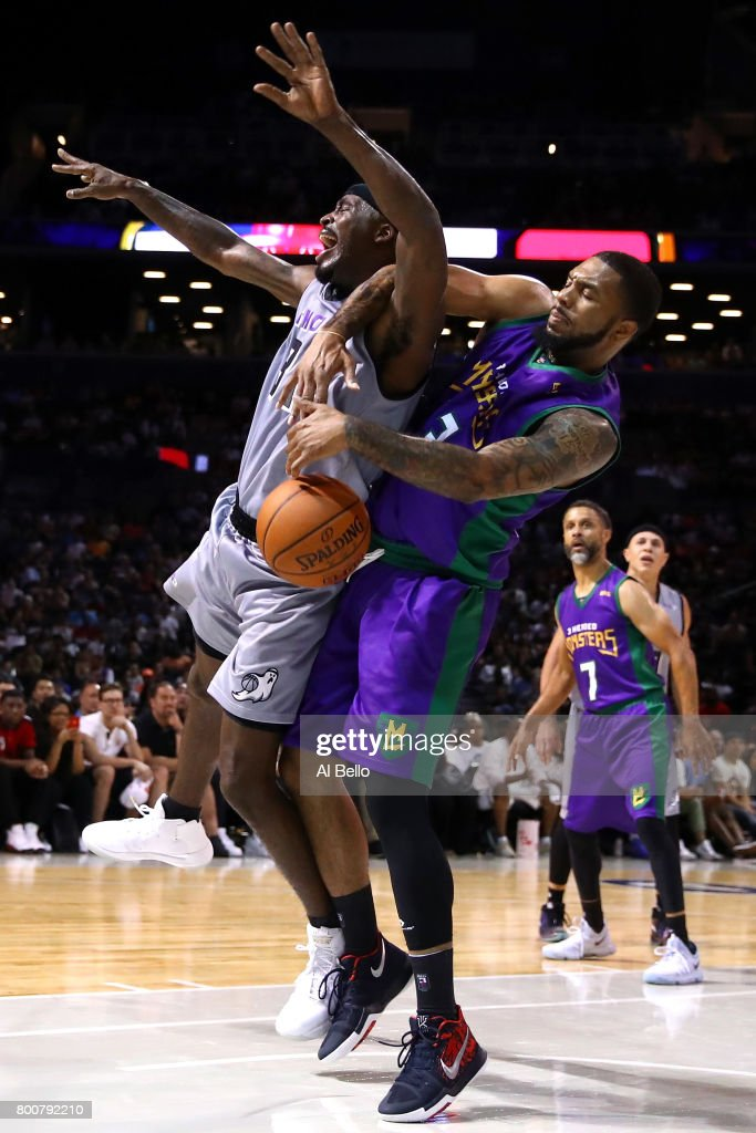 Eddie Basden #13 of the 3 Headed Monsters defends Ricky Davis #31 of the Ghost Ballers during week one of the BIG3 three on three basketball league at Barclays Center on June 25, 2017 in New York City.