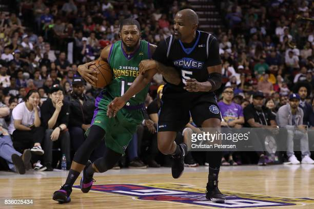 Eddie Basden of the 3 Headed Monsters handles the ball against Cuttino Mobley of the Power in week nine of the BIG3 threeonthree basketball league at...