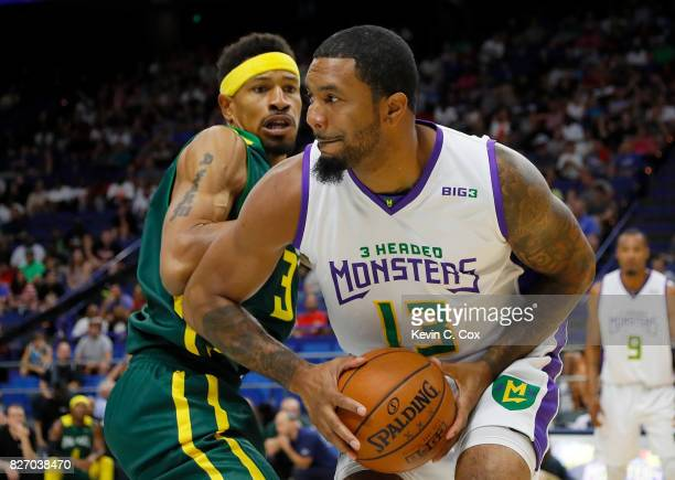 Eddie Basden of the 3 Headed Monsters is guarded by Desmon Farmer of the Ball Hogs during week seven of the BIG3 three on three basketball league at...