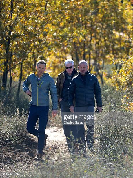 Eddie Bauer Philanthropic Ambassador Ryan Reynolds American Forests President and CEO Scott Steen and Eddie Bauer President and CEO Mike Egeck plant...